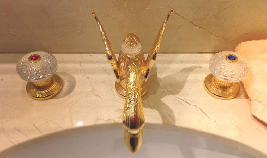 Gold taps and a peach towel - The Ritz Paris